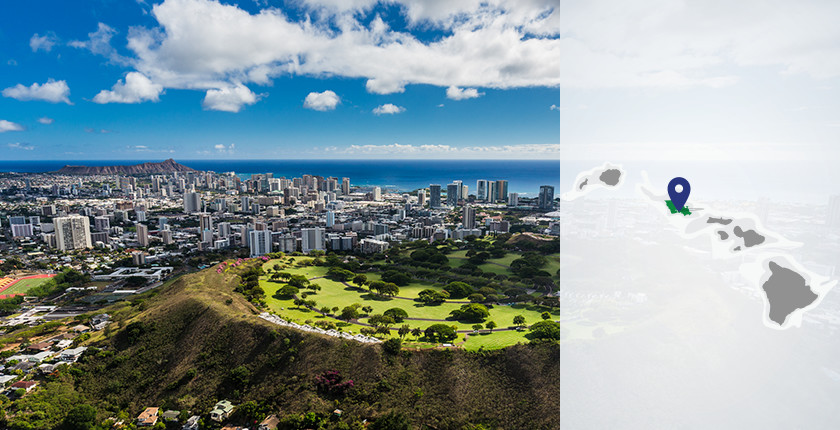 On the left, an aerial view of Honolulu's skyline. On the right, a gray map of the Hawaiian Islands with a blue map pin on top of Honolulu, Oahu.