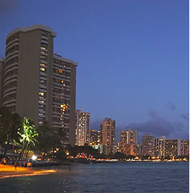 A beautiful shot of Waikiki's beach side at night.