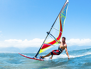 Guy wind-surfing at the beach