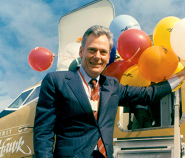 Herb dedicating The Spirit of Kitty Hawk on December 17, 1984. Herb negotiated a deal with Boeing for Southwest to become the launch customer for a redesigned variant of the already successful 737, building the relationship between the two companies that led to Southwest becoming the world's largest operator of the legendary airliner.