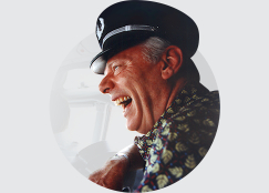 Herb Kelleher laughing, wearing Captain's hat
