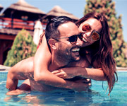 Couple embracing in pool
